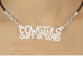 "<BR>                       EXCLUSIVELY OURS!!<Br>                AN ALLAN ROBIN DESIGN!!<bR>                      LEAD & NICKEL FREE!!<Br>W16361N - ""COWGIRLS CAN'T BE TAMED""<Br>  MARQUEE PENDANT & BROWN BRAIDED<Br> NECKLACE FROM $6.75 TO $15.00 ©2010"