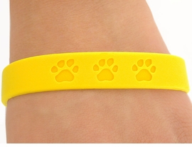 <bR>         EXCLUSIVELY OURS!!<Br>W4573JPB - SUNNY YELLOW<BR>  SCHOOL SPIRIT PAW JELLY<br>   BRACELETS©2004 FROM<Br>                $.97 TO $5.00