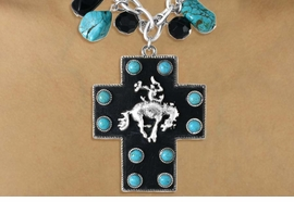 <Br>                    LEAD & NICKEL FREE!!<Br>W16275NE - GENUINE LEATHER BACKED<Br>BUCKING BRONCO & TURQUOISE COLOR<Br>    STONE CROSS NECKLACE & EARRING<BR>              SET FROM $12.38 TO $27.50