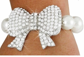 <Br>              LEAD & NICKEL FREE!!<Br>   W18664B - CREAM FAUX PEARL <Br>     AND SILVER TONE AUSTRIAN <BR> CRYSTAL ACCENTED BOW STRETCH<Br>  BRACELET FROM $8.44 TO $18.75