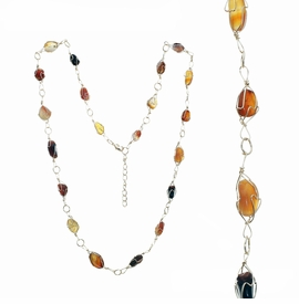 <BR>     W29512N12 - EXCITING NEW FASHION JEWELRY EXCLUSIVE <BR>  ADJUSTABLE GOLD-TONE WIRE NECKLACE WITH MULTIPLE SMOOTH<BR>AMBER AND TOPAZ TONED STONES IN GOLD-TONE WIRE SETTINGS <BR>                     NO NICKEL, LEAD, OR POISONOUS CADMIUM.  <br>                              BUY THIS NECKLACE FOR $11.25 EACH