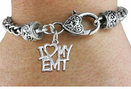 "<bR>       WHOLESALE EMT CHARM BRACELET <BR>                     EXCLUSIVELY OURS!! <BR>                AN ALLAN ROBIN DESIGN!! <BR>          CADMIUM, LEAD & NICKEL FREE!! <BR>        W1498SB - BEAUTIFUL SILVER TONE  <BR>     ""I LOVE MY EMT"" CHARM & HEART CLASP <BR>      BRACELET FROM $4.40 TO $9.20 �2013"