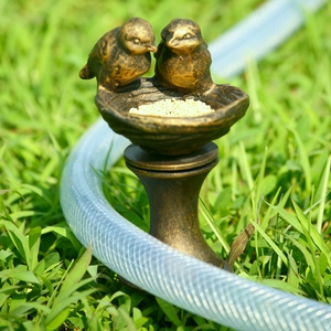 Aluminum Hose Guard with Feeding Lovebirds Figurine by SPI-HOME