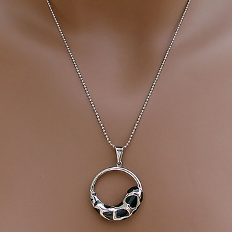 VINTAGE SPOTTED BLACK AND SILVER PENDANT