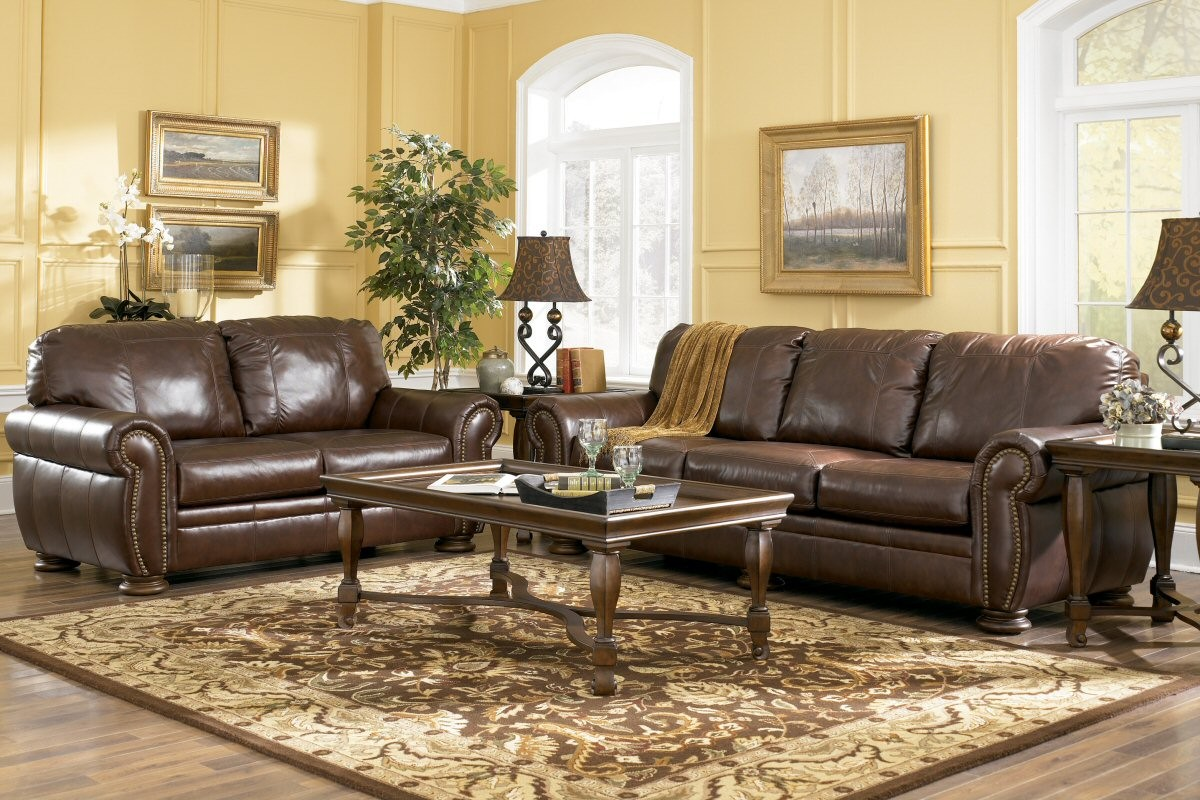 Ashley leather living room furniture for Living room sets