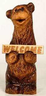 CHAINSAW CARVED ANJELICA BEAR WITH SIGN