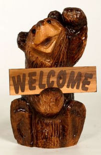 CHAINSAW CARVED CHUCK BEAR W/SIGN