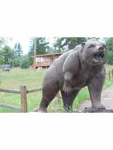 LIFE SIZE GRIZZLY BEAR ON ROCKS METAL SCUPLTURE