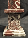 Deep maroon and white marble obelisk