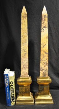 Tall specimen marble obelisks on brass plinths
