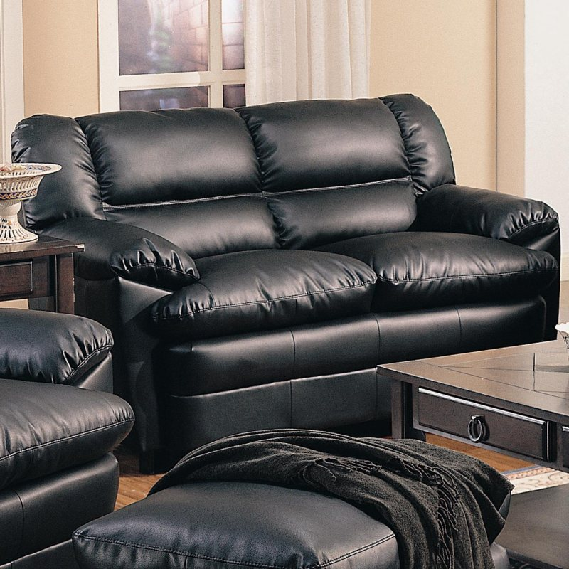Black overstuffed leather upholstered love seat with - Overstuffed leather sofa living room ...