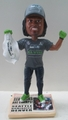 Marshawn Lynch (Seattle Seahawks) Super Bowl XLVIII Champ T-Shirt/Hat Exclusive Bobblehead #/500