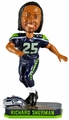 Richard Sherman (Seattle Seahawks) Forever Collectibles 2014 NFL Springy Logo Base Bobblehead