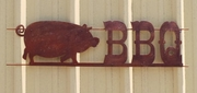 Large Rusted Metal BBQ with Pig Sign Horizontal
