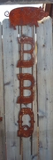 Large Rusted Metal BBQ with Pig Sign Vertical