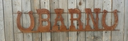Rusted Metal Barn with Horseshoes Sign