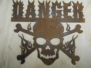 Rusted Metal Danger with Fire Skull and Cross Bones