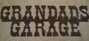 Rusted Metal Grandads Garage Sign