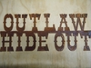 Rusted Metal Outlaw Hideout Sign