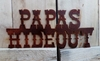 Rusted Metal Papas Hideout Sign