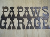 Rusted Metal Papaws Garage Sign