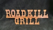 Rusted Metal Road Kill Grill Sign
