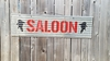 Saloon with Cowboy Heads Sandwich Sign