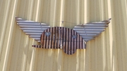 Corrugated Metal Wings with Vintage Travel Trailer