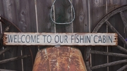 Welcome to Our Fishin' Cabin Distressed Wood Sign