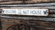 Welcome to the Nut House Distressed Wood Sign