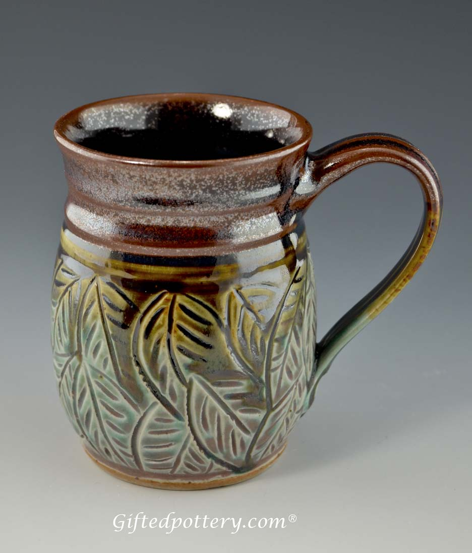 Handmade carved leaf quot mug in plum and green oz