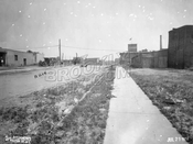 11th Avenue looking north toward 18th Street. Pilgrim Laundry in distance, 1924