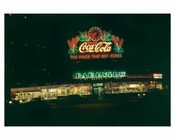 A classic Coca Cola Neon Sign Lighting up Manhattan 1955 NYC