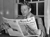 Actor Danny Kaye reading copy of The Heaving Line, during WWII