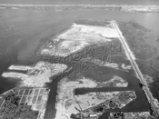 Aerial view of Barren Island, Bergen Beach, and Mill Basin, Rockaway Peninsula in distance; Flatbush Avenue on right, 1928
