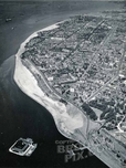 Aerial view of Bay Ridge, showing landfill behind new bulkhead. Fort Lafayette in bay, 1937