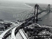 Aerial view of Fort Hamilton and Verrazano-Narrows Bridge near completion in 1964