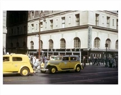 Yellow Taxis passing in front of Astor Bar