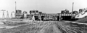 Avenue J looking east from East 14th Street, showing recently completed Brighton Line trestle, 1908
