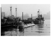 """Ben Franklin"" submerged in the harbor at the South Street Seaport with the Brooklyn Bridge in the Background 1969"