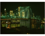 Brooklyn Bridge at night with the city glowing behind