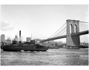 Brooklyn Bridge with the Fulton Ferry passing in front of it
