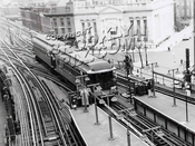 """BU"" 1300 series elevated cars on fan trip, seen at junction of Broadway and Myrtle elevateds, 1956"