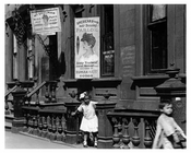 "Children playing on Lexington Avenue & 104th Street outside of a ""Hair Dressing Parlor"" 1911 - Upper East Side, Manhattan - NYC"