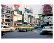 Classic Yellow Taxis passing through Times Square 1960s Midtown Manhattan
