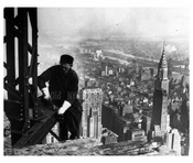 Construction worker atop Building with Midtown skyline & Chrysler Bldg