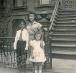 Family in front of brownstone, 1940s