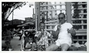 Farragut Pool 1950 - father and children eating ice cream outside