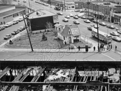 Flatbush Avenue at Avenue N; ruins of Bowling Alley fire in foreground, 1972
