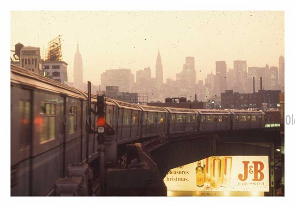 Flushing Train with city in sight